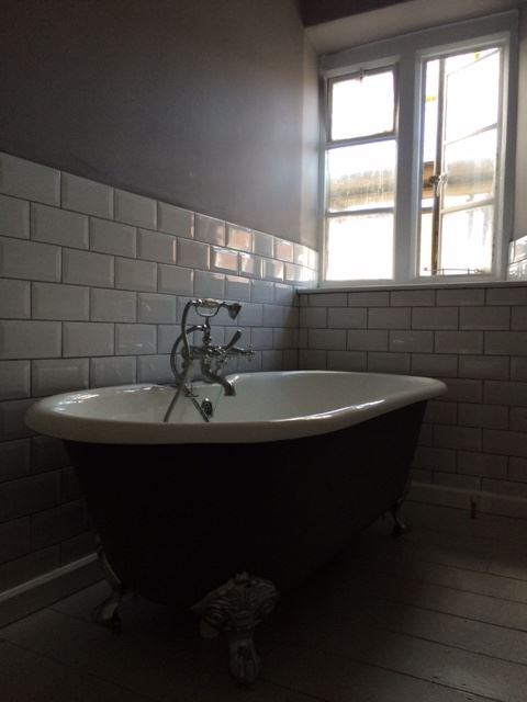 Reclaimed Bath in Street